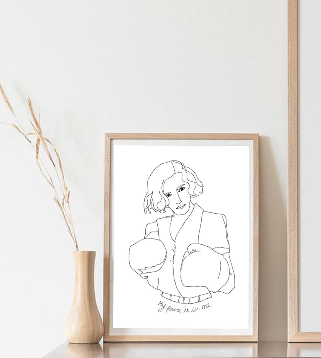Image d'un cadre en bois avec l'affiche A4 Freyja, une femme avec de gants de boxe