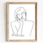 Image d'un cadre en bois avec l'affiche A4 d'une femme qui rêve, Themis