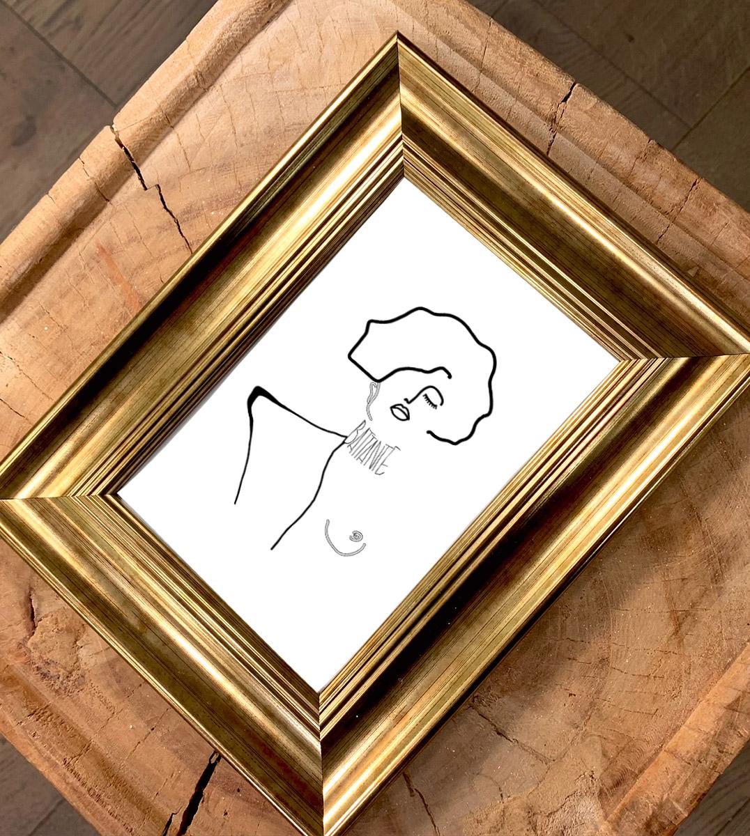 Image d'un cadre doré avec une carte postale d'un visuel inspiré d'un tableau de Gustav Klimt